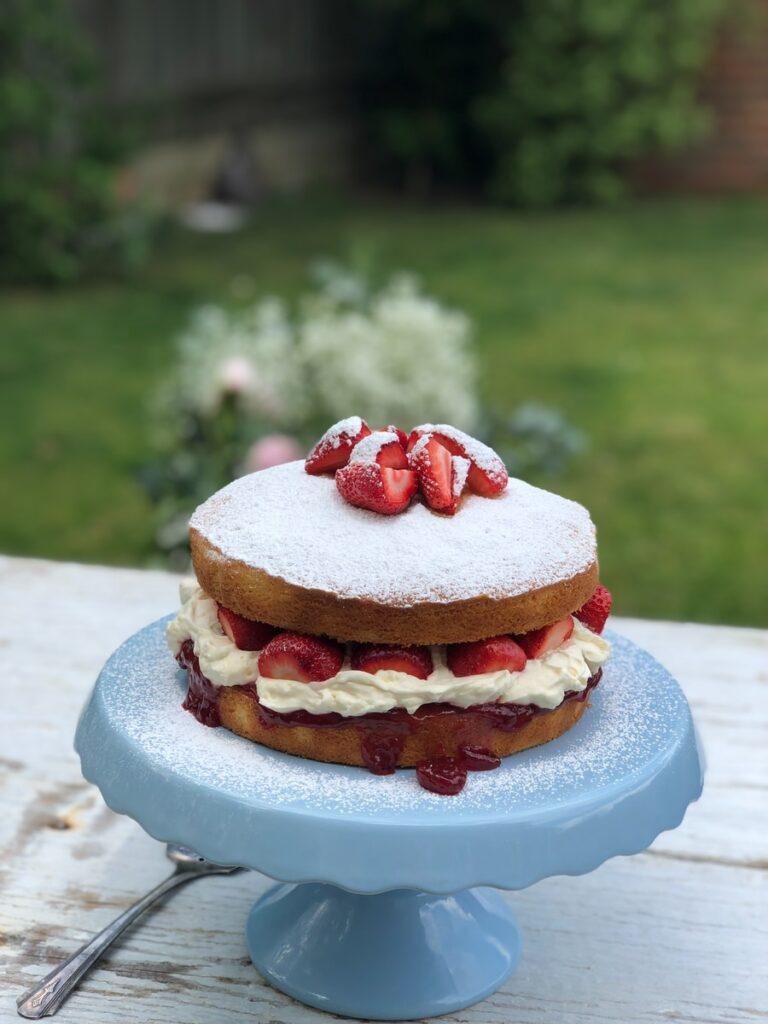 fruit cake on blue cake holder